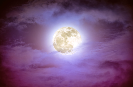 nightly: Attractive photo of a nighttime sky with clouds and bright full moon. Nightly sky with beautiful full moon. Outdoors at night. The moon were NOT furnished by NASA.