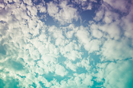 natural process: Beautiful white cloudy and blue sky in sunny day. Natural sky composition. A layer of broken stratus clouds under blue sky. Outdoors. Cross process and vintage effect tone.