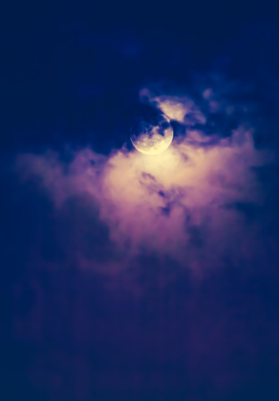 nightly: Attractive photo of background nighttime sky with clouds and bright full moon with shiny. Nightly sky with beautiful full moon behind cloud. Outdoors at night. The moon were NOT furnished by NASA.