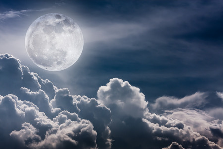 full moon effect: Attractive photo of background nighttime sky and bright full moon with shiny. Nightly sky with beautiful full moon and cloudy, outdoors. Vintage effect tone. The moon were NOT furnished by NASA.