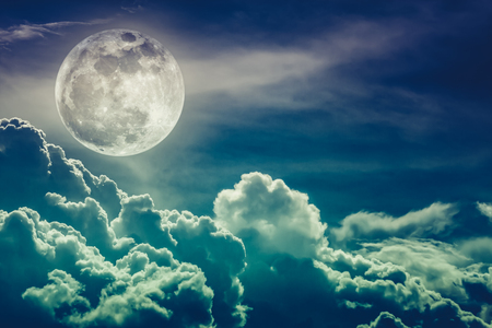 Attractive photo of background nighttime sky and bright full moon with shiny. Nightly sky with beautiful full moon and cloudy. Cross process and vintage tone. The moon were NOT furnished by NASA. Stock Photo