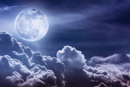 Attractive photo of background nighttime sky and bright full moon with shiny. Nightly sky with beautiful full moon and cloudy. Outdoors at night. The moon were NOT furnished by NASA. Stock Photo