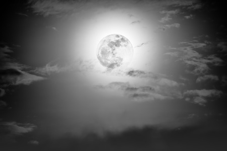 full moon effect: Background of nighttime sky with cloud and full moon with shiny. Natural beauty at night with moon behind cloud in black and white style. Vintage effect tone.