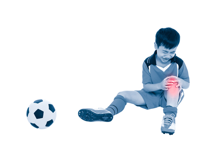 injurious: Sports injure. Youth asian soccer player with football in uniform injured at his knee. Isolated on white background. Full body. Color increase blue skin and red spot indicating location of pain. Stock Photo