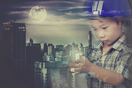 full moon effect: Double exposure of asian child with blue helmet combined with skyscrapers different construction and full moon in dark town. Vintage effect tone. The moon were NOT furnished by NASA. Stock Photo