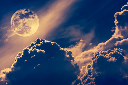 Super moon. Attractive photo of background night sky with cloudy and bright full moon. Nightly sky with beautiful full moon. Vintage tone effect. The moon were NOT furnished by NASA. Stock Photo