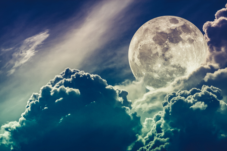 Super moon. Attractive photo of background night sky with cloudy and bright full moon. Nightly sky with beautiful full moon behind clouds. Cross process. The moon were NOT furnished by NASA.