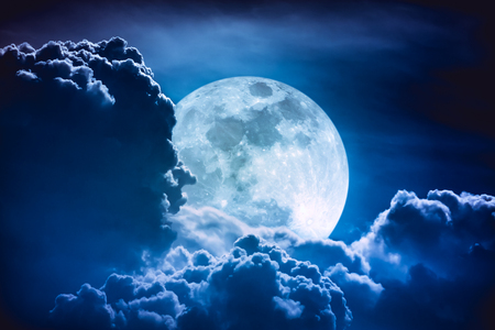Super moon. Attractive photo of background night sky with cloudy and bright full moon. Nightly sky with beautiful full moon behind clouds. The moon were NOT furnished by NASA.