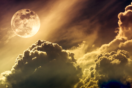 Super moon. Attractive photo of background night sky with cloudy and bright full moon. Nightly sky with beautiful full moon. Sepia tone. The moon were NOT furnished by NASA. Stock Photo