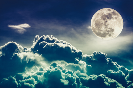 Attractive photo of background night sky with cloudy and bright full moon. Nightly sky with beautiful full moon behind clouds. Cross process. The moon were NOT furnished by NASA. Stock Photo