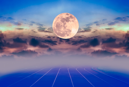 racetrack: Beauty sky with super moon and silhouette of clouds over racetrack for running. Backstretch or racecourse with foggy. Outdoors in the evening. Dark tone style. The moon were NOT furnished by NASA. Stock Photo