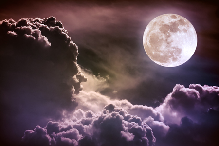 Attractive photo of background night sky with cloudy and bright full moon. Nightly sky with beautiful full moon. Vintage tone effect. The moon were NOT furnished by NASA.
