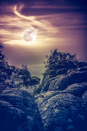 Landscape of night sky with beautiful bright  full moon above view point on the top of mountain, serenity nature background. The moon taken with my own camera. Vintage effect tone.