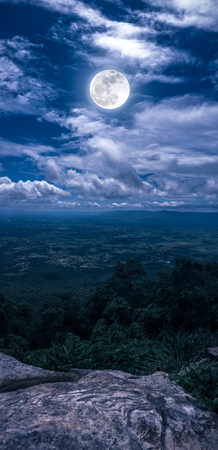 Landscape of night sky with cloudy, idyllic view from scenic point on mountain. Beautiful bright full moon, serenity nature. Vertical panoramic composition. The moon taken with my camera. Archivio Fotografico
