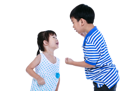 enmity: Quarreling conflict between brother and sister. Asian children are arguing and fighting. Concept about family & relationship problems. Isolated on white background.