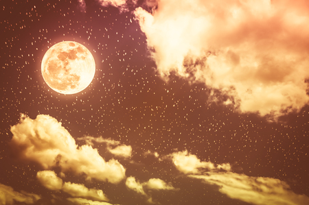 Beautiful cloudscape with many stars. Night sky with bright full moon and cloudy, serenity blue nature background. Outdoor at nighttime with moonlight. Sepia tone. The moon taken with my own camera.