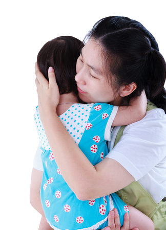 Asian mother carrying and embraces to comfort her daughter with love. Happy family spending time together. Isolated on white background. Mothers Day celebration. Studio shot.
