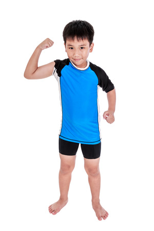 Full body of children powerful. Asian strong and confident boy cyclist is flexing biceps muscle fitness exercise and smiling happily. Healthy child lifestyle. Isolated on white background. Studio shot.