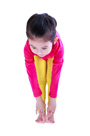 Full body of asian pretty child stretched bending down before doing yoga exercise. Healthy chinese girl warming up at studio. Sports and active lifestyle. Isolated on white background.
