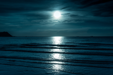 Colorful sky with cloud and bright full moon over seascape in the evening. Serenity nature background, outdoor at nighttime. The moon taken with my own camera. Stock fotó