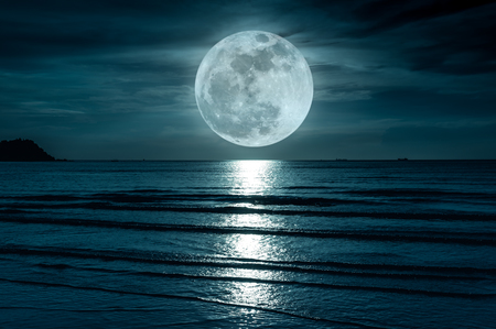 Super moon. Colorful sky with cloud and bright full moon over seascape in the evening. Serenity nature background, outdoor at nighttime. The moon taken with my own camera.