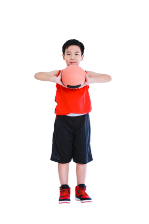 only boys: Full body of young asian basketball player in sportswear standing and prepare to throw the ball. Handsome boy smiling and looking at camera. Studio shot. Isolated on white background. Stock Photo