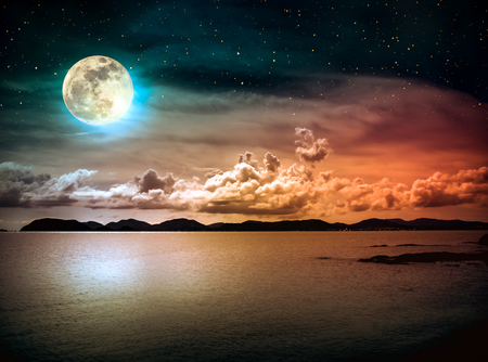 Beautiful landscape view of the sea with many stars . Attractive dark sky with cloud and  full moon on seascape to night. Serenity nature background. High contrast. The moon taken with my own camera.