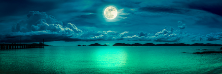 Panorama view of the sea. Colorful sky with cloud and bright full moon on seascape to night. Serenity nature background, outdoor at nighttime. Cross process. The moon taken with my own camera.