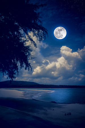 Beautiful landscape view on seascape to night. Attractive many stars and bright full moon on dark blue sky with cloudy. Serenity nature background, outdoors at nighttime. The moon taken with my own camera.