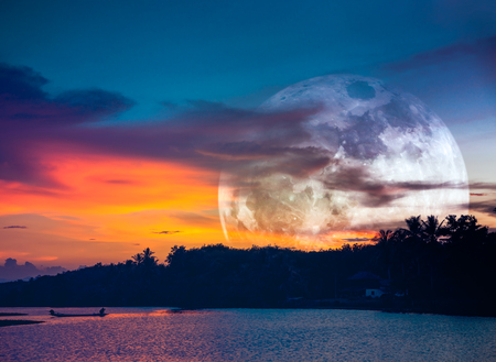 Beautiful landscape at night. Attractive super moon on colorful sky with cloud above silhouettes of trees at riverside. Serenity nature background. The moon taken with my camera.