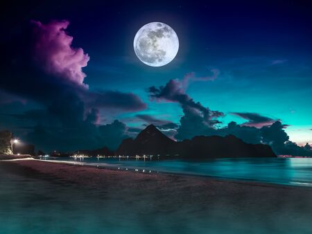 Beautiful view of the sea. Colorful blue sky with cloud and bright full moon on seascape to night. Serenity nature background outdoor at nighttime. The moon taken with my own camera.