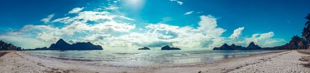 Relaxing seascape tropical paradise beach with white sand and island in the sea. wide panorama background concept