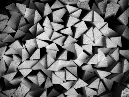 Abstract black and white background. Triangles the same shape of polystyrene foam material.