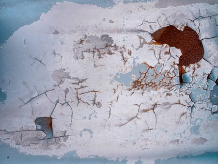 Worn rusty metal surface with paint flaking and cracking texture background.
