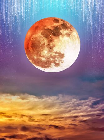 Photo Manipulation. Beautiful colorful skyscape with many stars and meteor shower. Landscape of night sky with super moon and cloudy. The moon were not furnished by NASA. Stock Photo