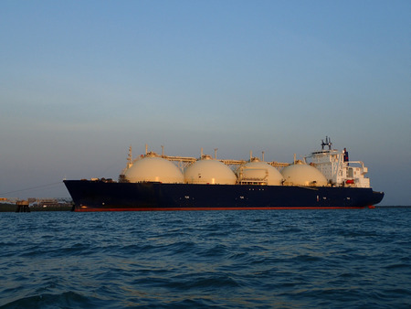 Gas ship being loaded while docked