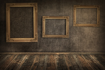 Three vintage frames on the wall  photo
