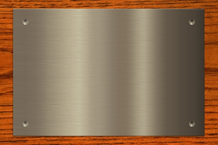 Metal plate on wooden background  photo