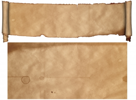 Scroll of antique parchment and sheet of old paper