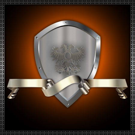 Ornate heraldic shield and silver ribbon  photo