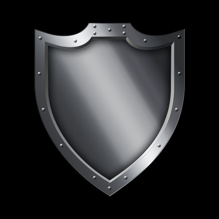 riveted: Medieval shield with chrome riveted border on black background. Stock Photo