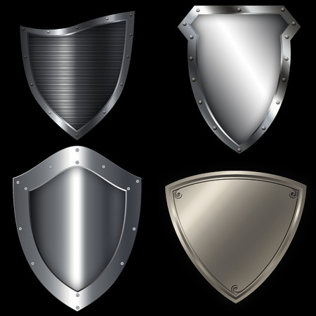 shield set: Medieval silver shield set. Isolated object on black background for the design.