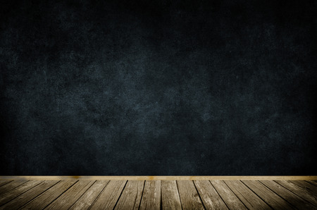 backgrounds grungy dots: Old wooden frame on dark grunge wall and wooden floor. Stock Photo