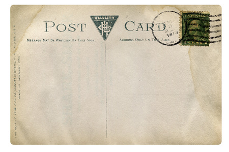 Old postcard with stamp and mark. photo