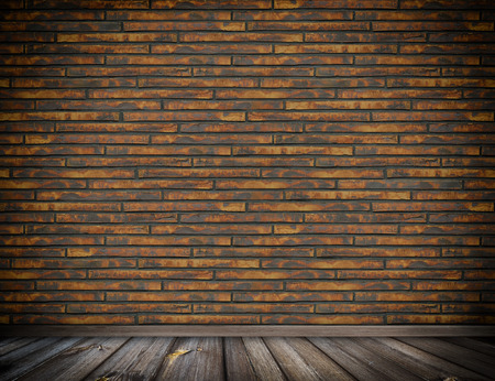 Old bricks wall and wooden floor background for the design. photo