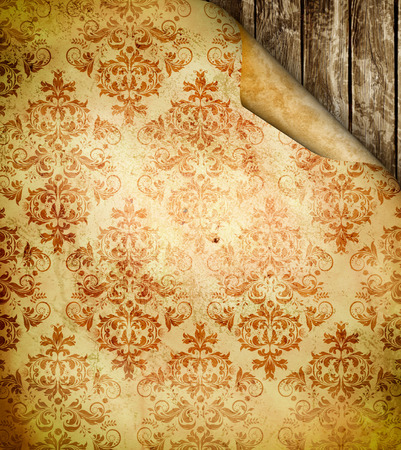 Old grunge paper background with old-fashioned ornament on old wooden wall for the design. photo