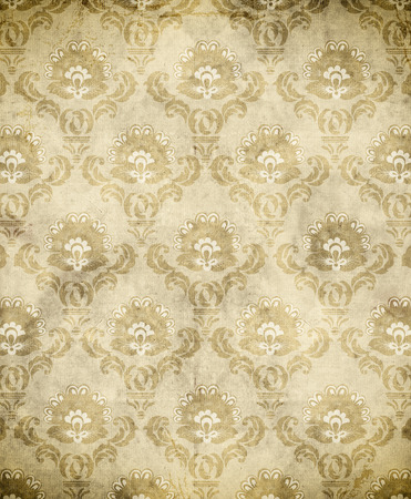 Old-fashoned european floral patterns on old grunge paper background. photo
