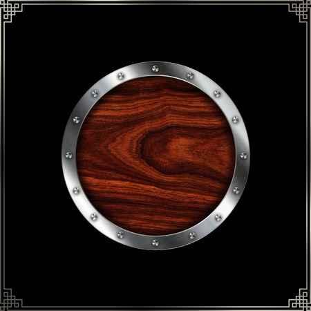 black metallic background: Wooden plate with riveted shiny metallic border for the design. Isolated on black background. Stock Photo