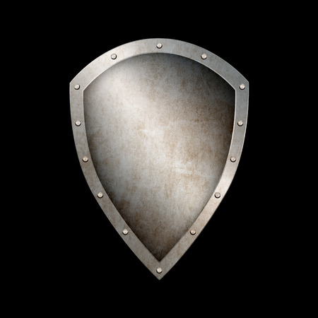 riveted: Rusty medieval shield with riveted border on black background. Stock Photo