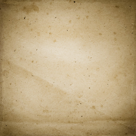 close uo: Old dirty paper backdrop with grunge effect. Natural old paper texture. Stock Photo
